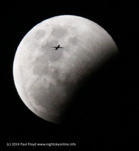 A plane flies in front of the partially eclipsed Moon on October 8 2014 (c) Paul Floyd.